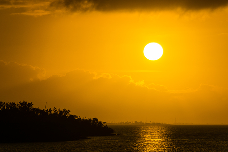 USA, Florida, Orange light reflecting over the ocean water of florida keys