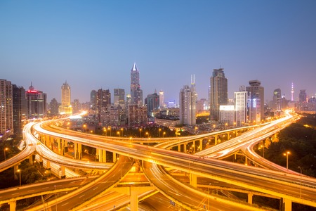 a big asia city by night to the sunrise with all the lights on the streets and skyline Editorial