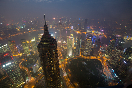 a big asia city by night to the sunrise with all the lights on the streets and skyline Stock Photo - 107544239