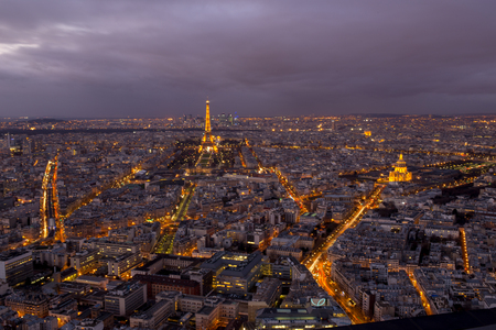 paris in the night and dawn with glowing streets and the eiffel tower