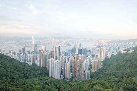 a city in asia with traffic and a river between skyscrapers