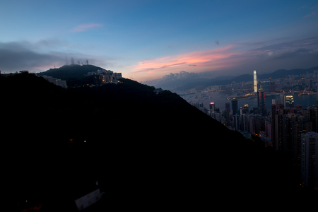 a big asia city by night to the sunrise with all the lights on the streets and skyline Stock Photo