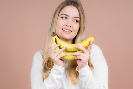 a girl plays with a banana and had fun