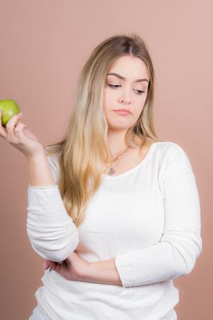 a girl with an apple having fun