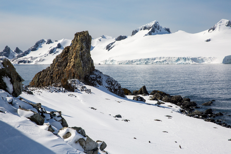 icecaps in the Antarctica with iceberg in the ocean swimming around and melting in the sea Stock Photo