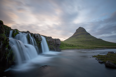 a waterfall in iceland between the mountains from the river spring 스톡 콘텐츠