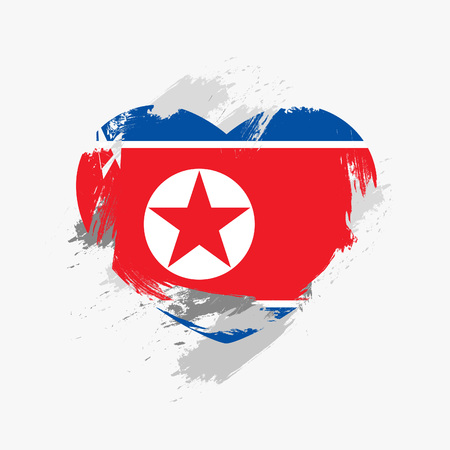 Flag of North Korea isolated on grunge heart.