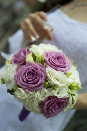 Bride holding an elegant bouquet or bunch of flowers Stock Photo