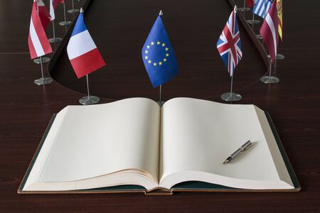 Open spread book, fountain pen, EU  European Union  flags Stock Photo