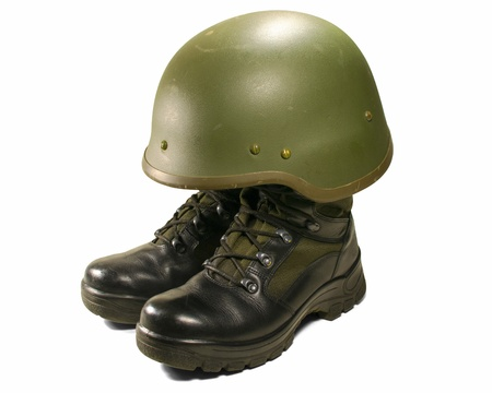 safety boots: Soldier concept: military boots and helmet Stock Photo