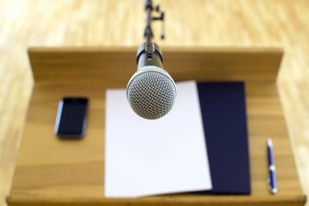 tribune: Microphone at the speech podium Stock Photo