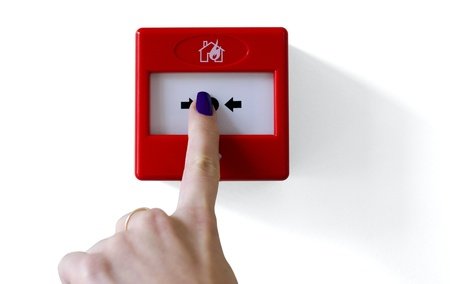 Fire alarm trigger button being pressed by female finger  Isolated 版權商用圖片