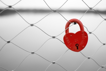 locked: Love padlock on a bridge fence. Russian proverb saying May You Live Happily!