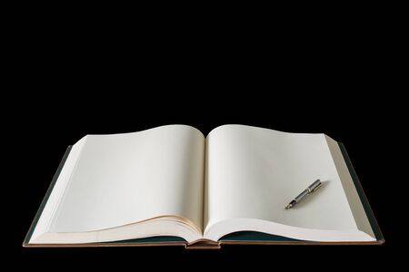 Large open spread book and fountain pen isolated on black