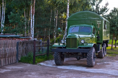 frontline: World War II military truck, shiny and as new  Birch forest