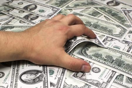 grabbing hand: Greedy hand grabbing money