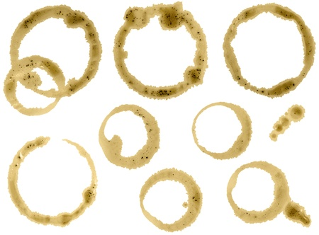 Coffee cup stain isolated on white background. Separate clipping paths.