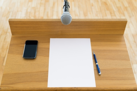 Speech podium with a microphone  First person view Stock Photo