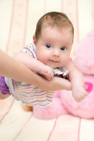 2 months old baby girl on mother s arms Stock Photo