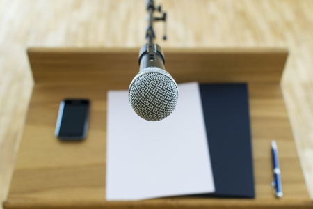 public speaking: Microphone at the speech podium Stock Photo