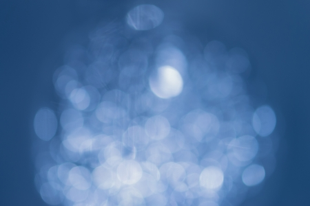 Natural smooth bokeh on blue background