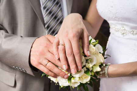 Wedding  Groom and bride holding their hands on a bouquet