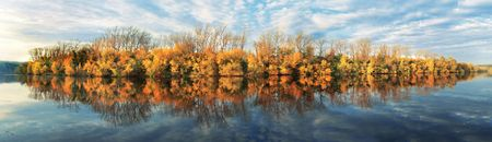 panorama with autumn trees and clouds photo
