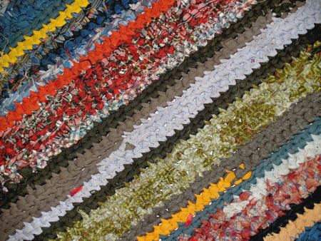 handicraft rug with the many colored stripes photo