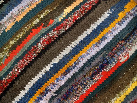 striped colorful handicraft rug from cotton fabric photo