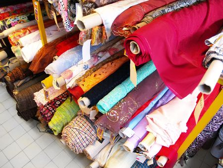 buying stock: The warehouse of stocks of  fabric and textile    Stock Photo
