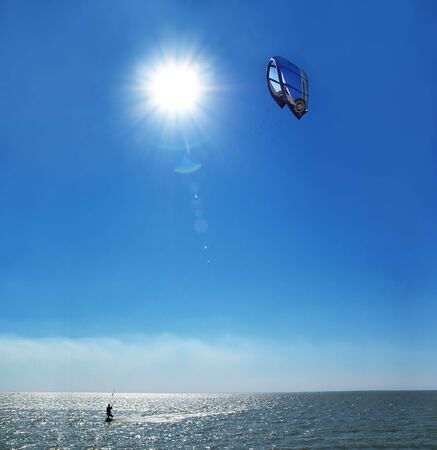 man with kite on sea surface Stock Photo - 2273674