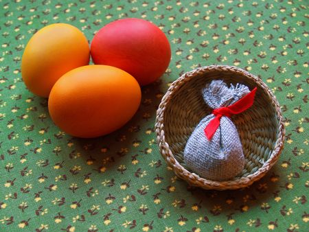 sateen: two eggs and small sack on the green backgroung