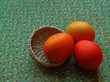 arisen: three eggs on green glazed cotton background