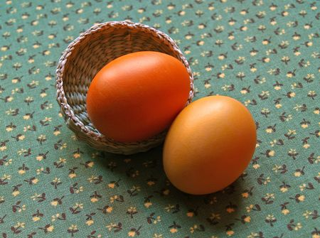 arisen: two painted eggs with basket on green background  Stock Photo