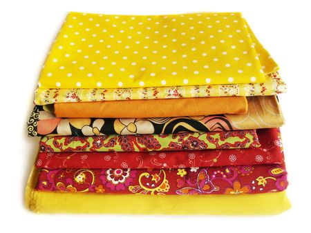 fancywork: Colored cotton fabrics on white background. Textile for patchwork and sewing Stock Photo