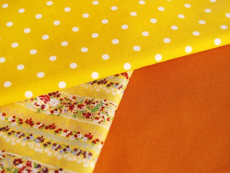 fancywork: Yellow textiles with different prints for sewing and patchwork