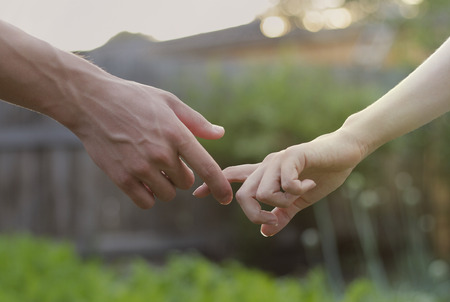 Boy and girl are kept in hand Stock Photo