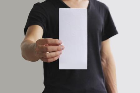 pamphlet: Man showing blank white flyer brochure booklet. Leaflet presentation. Pamphlet hold hands. Man show clear offset paper. Sheet template. Booklet design sheet display read first person.