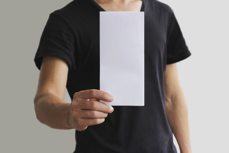 offset views: Man showing blank white flyer brochure booklet. Leaflet presentation. Pamphlet hold hands. Man show clear offset paper. Sheet template. Booklet design sheet display read first person.