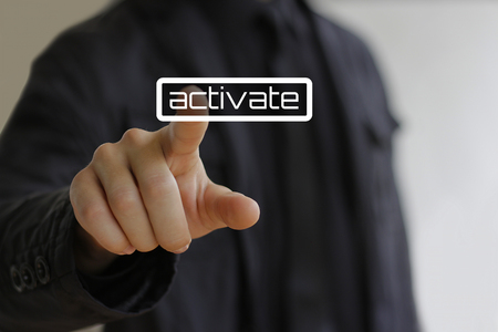 activate: Businessman clicks on the activate button