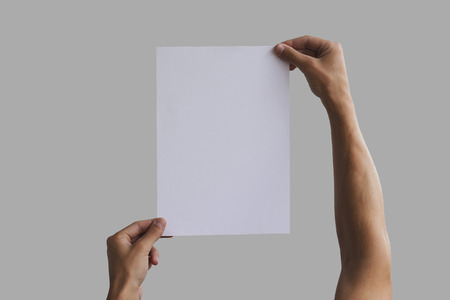 note booklet: Hand holding A4 paper in the hand. Leaflet presentation. Pamphlet hand man. Man show offset paper. Sheet template. Book in hands. Booklet folding design. Fold paper sheet display read. Stock Photo