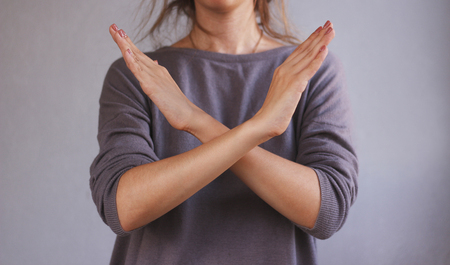 Girl shows no hands. Isolated on gray background. Banque d'images
