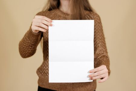 note booklet: Girl showing blank black flyer brochure. Detailed booklet. Leaflet presentation. Pamphlet hold hands. Woman show clear offset paper. Sheet template. Booklet design sheet display read first person Stock Photo