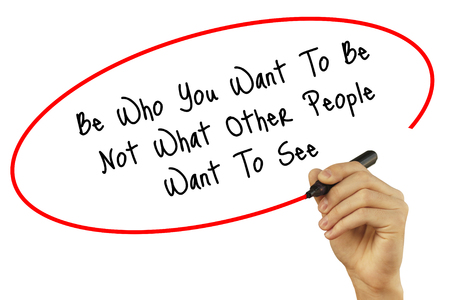 Man Hand writing Be Who You Want To Be Not What Other People Want To See with black marker on visual screen. Isolated on background. Business, technology, internet concept. Stock Photo