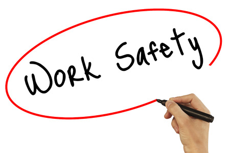 or electrocution: Man Hand writing Work Safety with black marker on visual screen. Isolated on grey. Business, technology, internet concept. Stock Photo