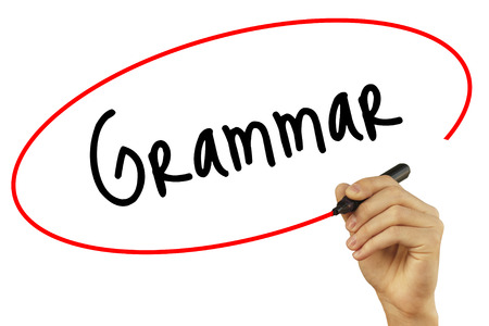 Man Hand writing Grammar with black marker on visual screen. Isolated on background. Business, technology, internet concept. Stock Photo Stock Photo