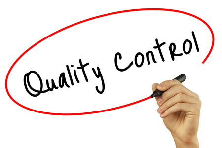 Man Hand writing Quality Control with black marker on visual screen. Isolated on background. Business, technology, internet concept. Stock Photo Stock Photo