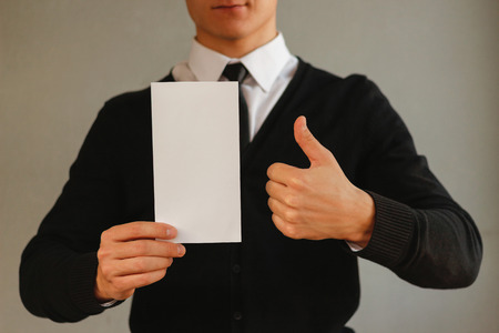 offset up: Business man showing blank white flyer brochure booklet and thumb up. Leaflet presentation. Pamphlet hold hands. Man show clear offset paper. Sheet template. Booklet design sheet display read first person