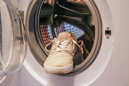 Dirty white sneakers in the washing machine