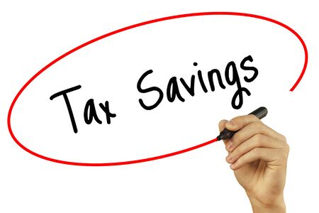 Man Hand writing Tax Savings with black marker on visual screen. Isolated on background. Business, technology, internet concept. Stock Photo